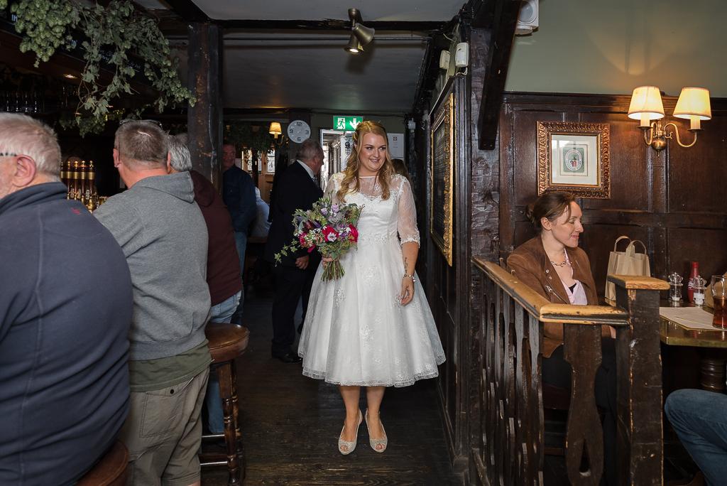 Bride leaving for wedding ceremony from The Sun Inn Faversham Kent | Oakhouse Photography