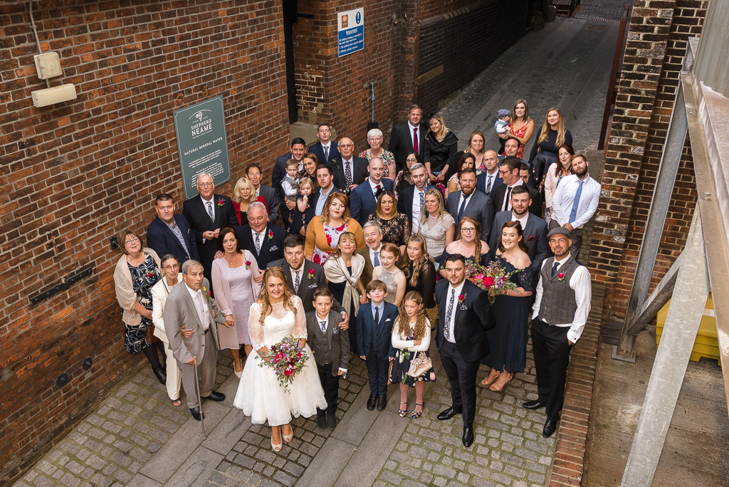 Wedding party group shot in The Street at the Shepherd Neame Brewery Faversham Kent | Oakhouse Photography