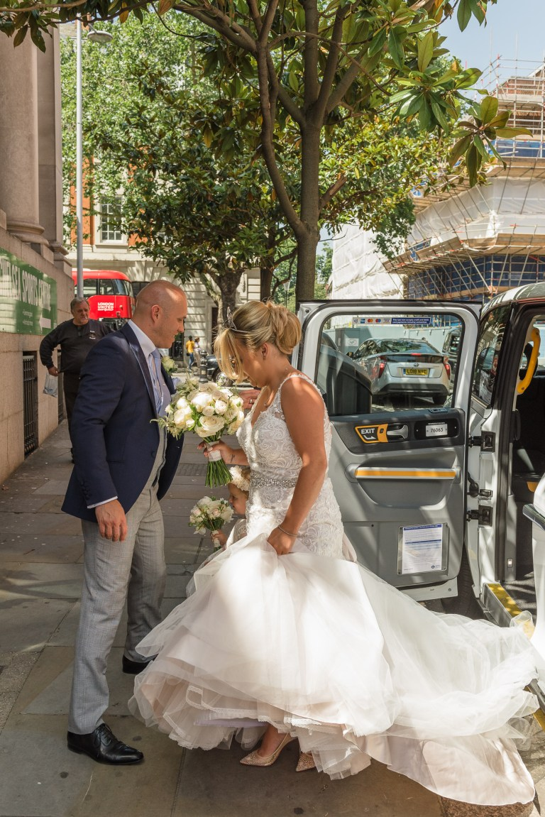 Bride arriving for her wedding at Chelsea Old Town Hall, King's Road, London | Oakhouse Photography