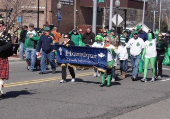 St. Patrick's Day parade participants walking in Royal Oak.