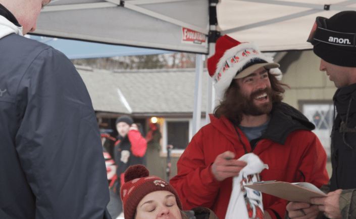 Professional snowboarder Danny Davis speaks to people attending the Merry Mitten Classic.