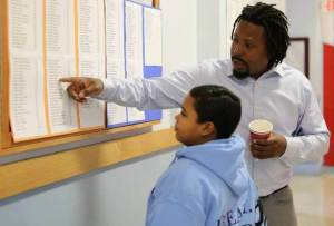 Oakland School Teacher Helping Student