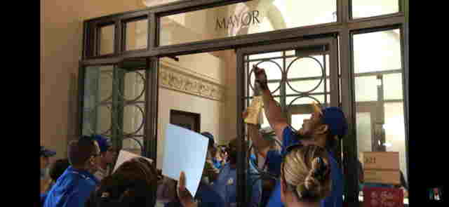 City Of Oakland Workers March Into Mayor Schaafs Office