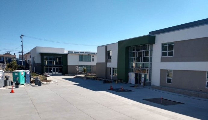 Fremont High's new academic building (left) and the newly revamped academic building.