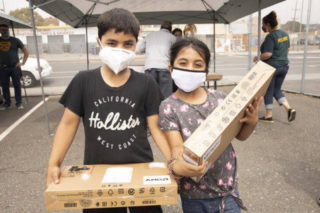 OUSD students with their Oakland Undivided devices which they can use to access the OUSD Digital Library.