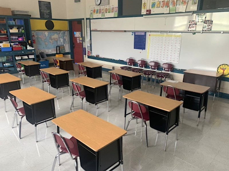 desks spaced apart in a classroom