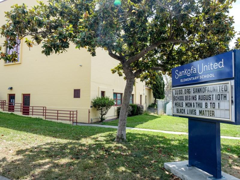 sankofa united school sign