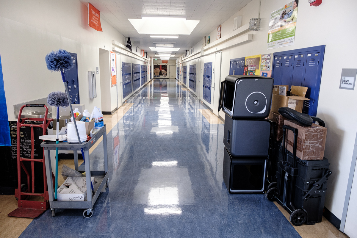empty hallway with cleaning supplies