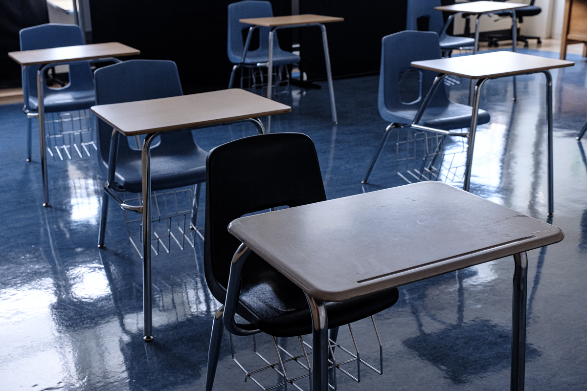 empty desks and chairs in a classroom