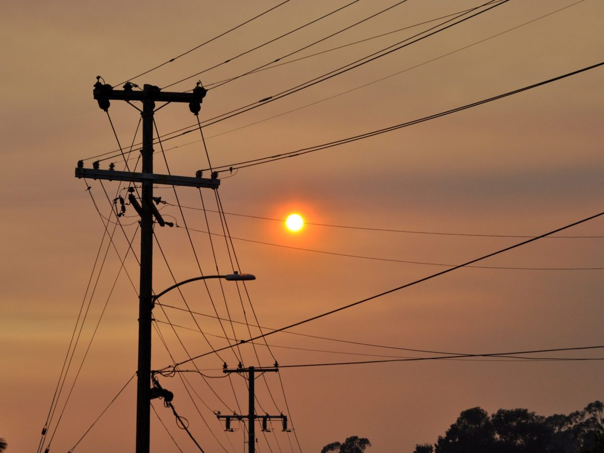 Power lines against a smoke-filled sky in Oakland