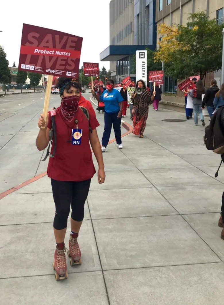 Ashley Chow, resident skater and oncology nurse at Oakland Kaiser Permanente, protests for appropriate staffing and more PPE during the onset of the pandemic, outside the hospital with other staff.