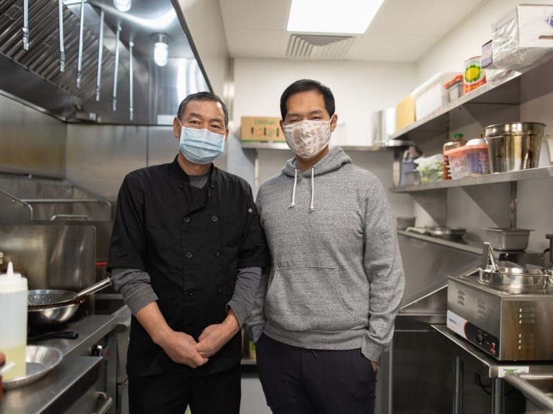 Father and son co-owners, Sheguang Zao and Dan Zhao respectively, in their ghost kitchen work space for Cozy Wok, a vegetarian and vegan Chinese restaurant.