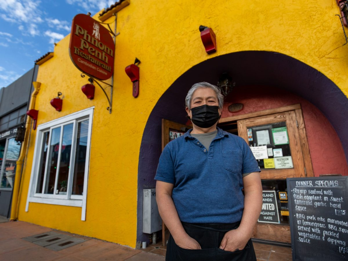 A portrait of Hong Do, owner and founder of Phnom Penh standing outside of the restaurant.