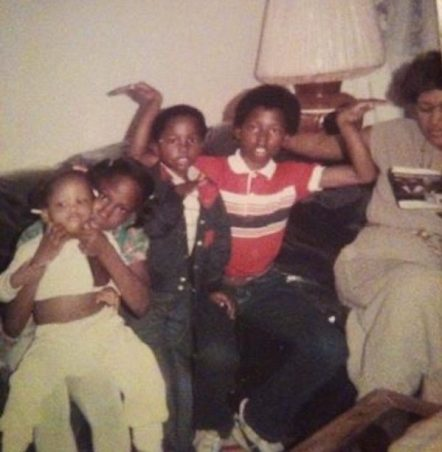 John Jones III (in red shirt) with his brother, sister, cousin, and aunt at their apartment on 92nd Avenue in East Oakland, circa 1984.