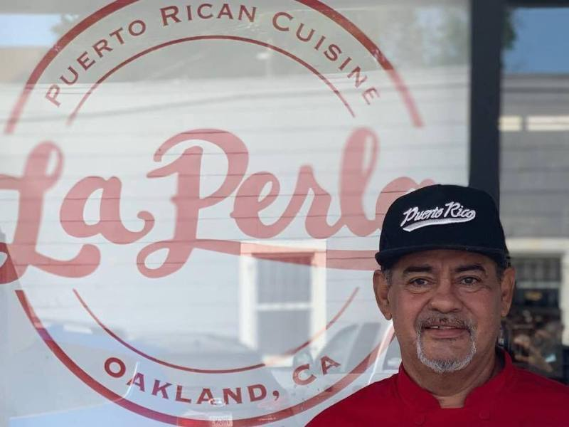 "Chef Jose ""Chem"" Ortiz standing in front of the new, soon to be opened location of La Perla in Oakland's Dimond district."