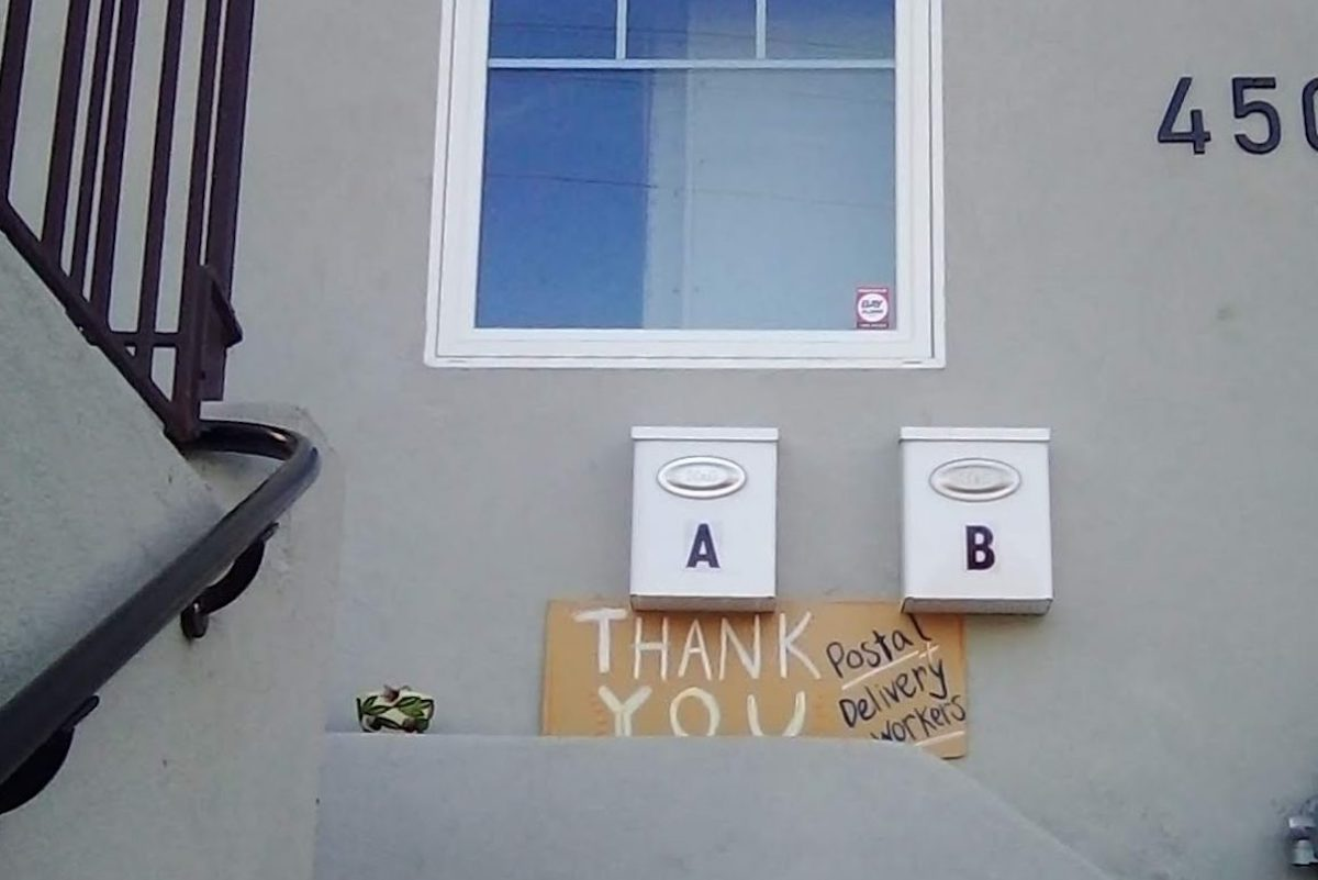 A sign thanking essential workers on one of the homes of the author's deliveries in Oakland.