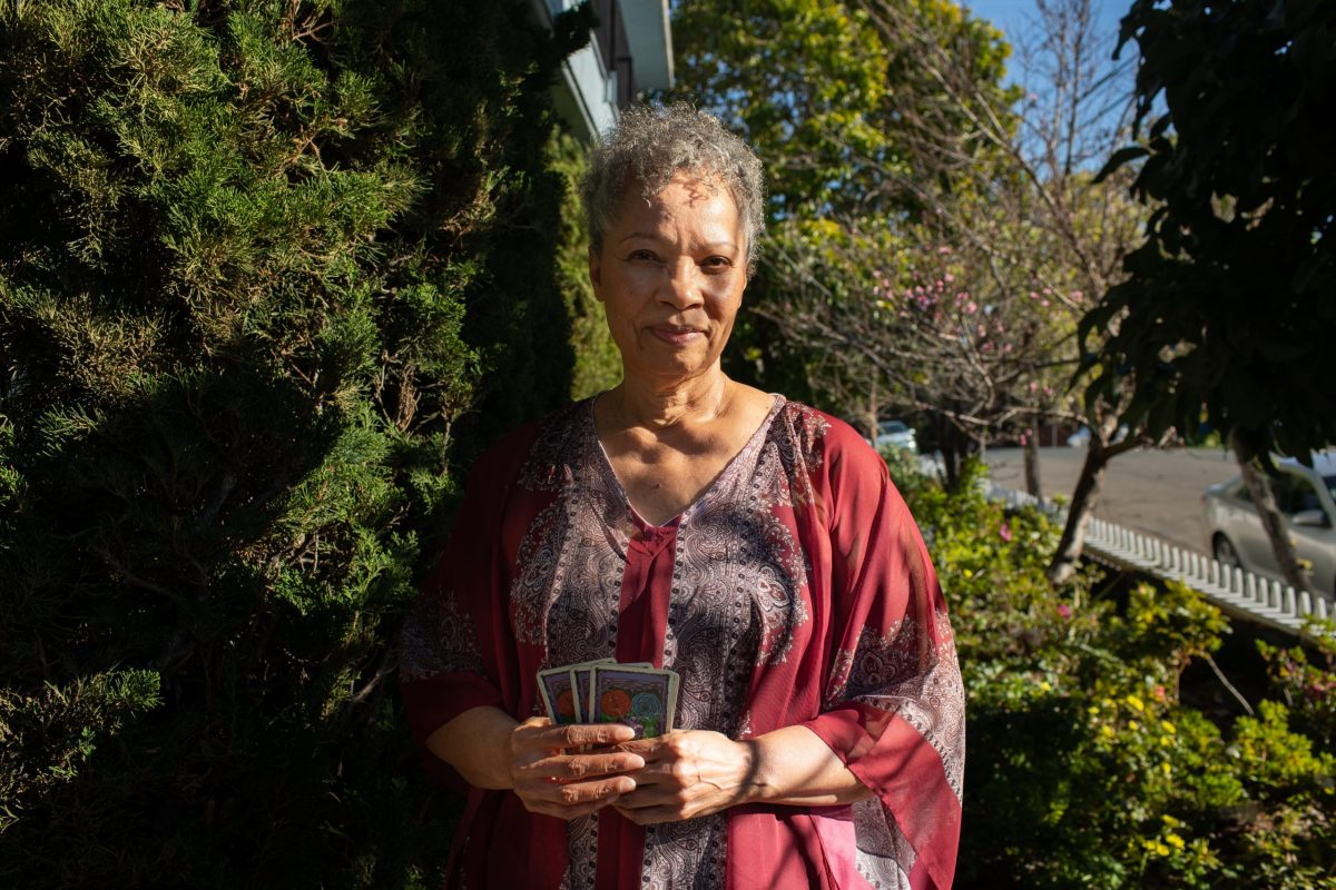 Alia Curtis of Intuitive Tarot Card Readings at her home.