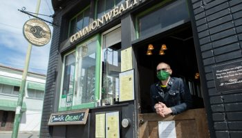Josh Rosenberg, owner of Commonwealth hangs out of the bar located on Telegraph.