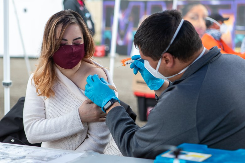 Itzel Diaz, an essential worker at Unity Council gets her second dose of vaccine from the Native Ameican Health Center site in Fruitvale.