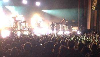 a wide shot of a crowd concert