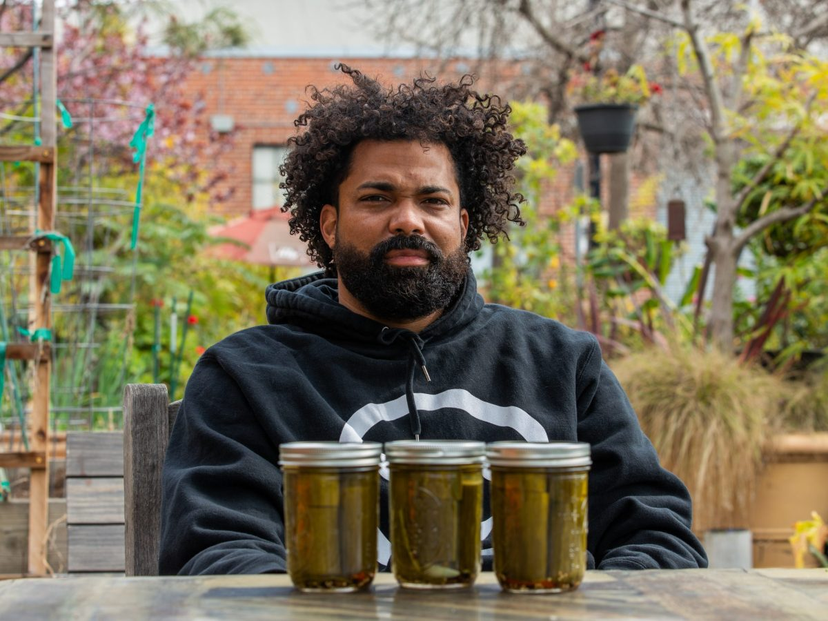 Manny McCall, chef and former server as Zuni Cafe now owner of Pickle Pana, selling pickles and donating money to those in need.