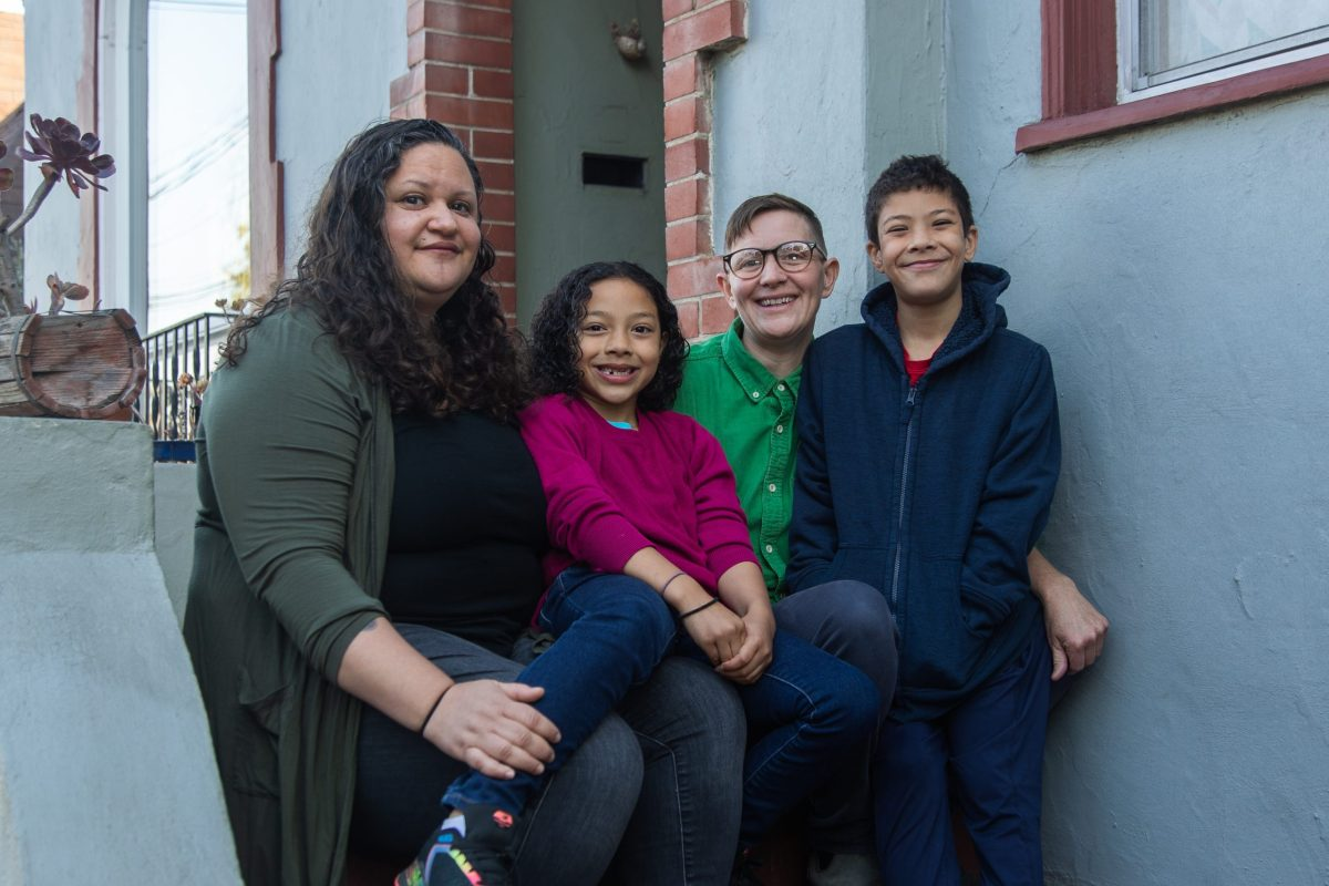 Chela Delgado, her partner and their kids at their home before at-home school starts.