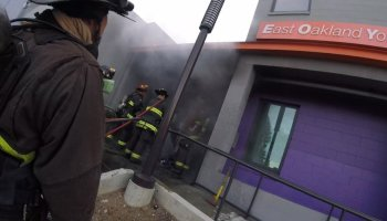 firefighters entering building
