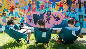 students in camping chairs