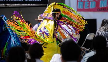 A dancer captivates attendees at the Indigenous Red Market at the Native American Health Center parking lot in Fruitvale, on May 2, 2021.