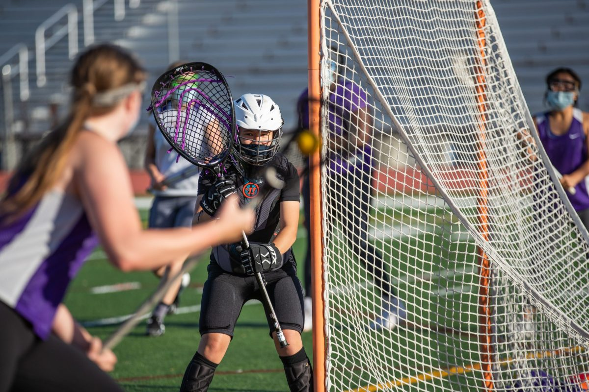 lacrosse players practicing