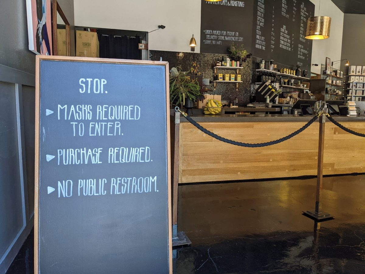 A sign awaiting customers at Awaken Cafe & Roasting on Broadway in downtown Oakland.