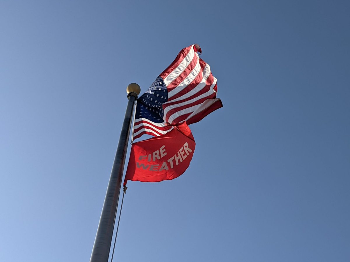 A red flag warning of increased fire danger flies at the Oakland Fire station No. 17 on High Street on Aug. 17, 2021.