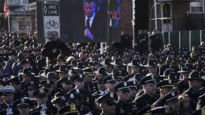 "NYC cops turn their backs on de Blasio. Taking responsibility for administering capitalism in the city, de Blasio has to concede to the forces of ""law and order""."