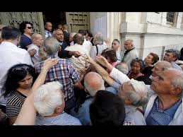 Angry crowd gathers at the entrance to a closed bank in Greece.