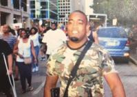 "This man was photographed carrying a rifle at the protest in Dallas. As Texas is an ""open carry"" state, that was perfectly legal. Yet the police circulated his photo as a suspect in the police killing there. He turned himself in and was accused and lied to by the cops for an extended time before he was released, because he was completely uninvolved in the shooting. Where are the ""gun rights"" advocates in this case? For them, carrying arms only applies to white, right-wing bigots."