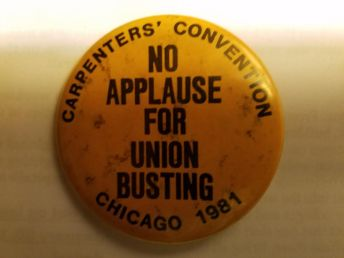 """""""No Applause for Union Busting"""" Notice there is no union label - the union """"bug"""" - on the button. The story behind this: Some delegates to the 1981 Carpenters Union convention got this button printed up in Chicago for when Reagan was set to appear. The union leadership got wind of it and called around to every union shop that made buttons and told them that if they printed up this button they never would get any union business again, so all the union shops refused the job so they were made at a non-union shop. Then, the Carpenters leadership refused to allow any delegates into the convention who were wearing a button without a union """"bug"""".  Clearly, though, they have nothing against scabbing; it was just a ruse in order to be able to kiss up to the likes of Reagan (then) and Trump now."""