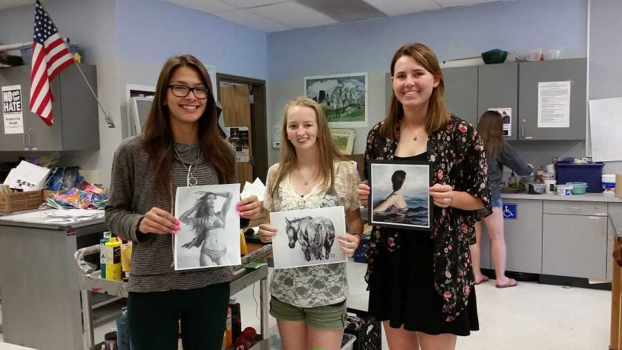 Senior Laura Woo, junior Lauryn Wood and junior Hannah Rose Balke pose with their winning artwork. All three artists represented Oak Park High School at the Westlake Village Art Guild competition along with two other students (Photo Illustration/Talon)
