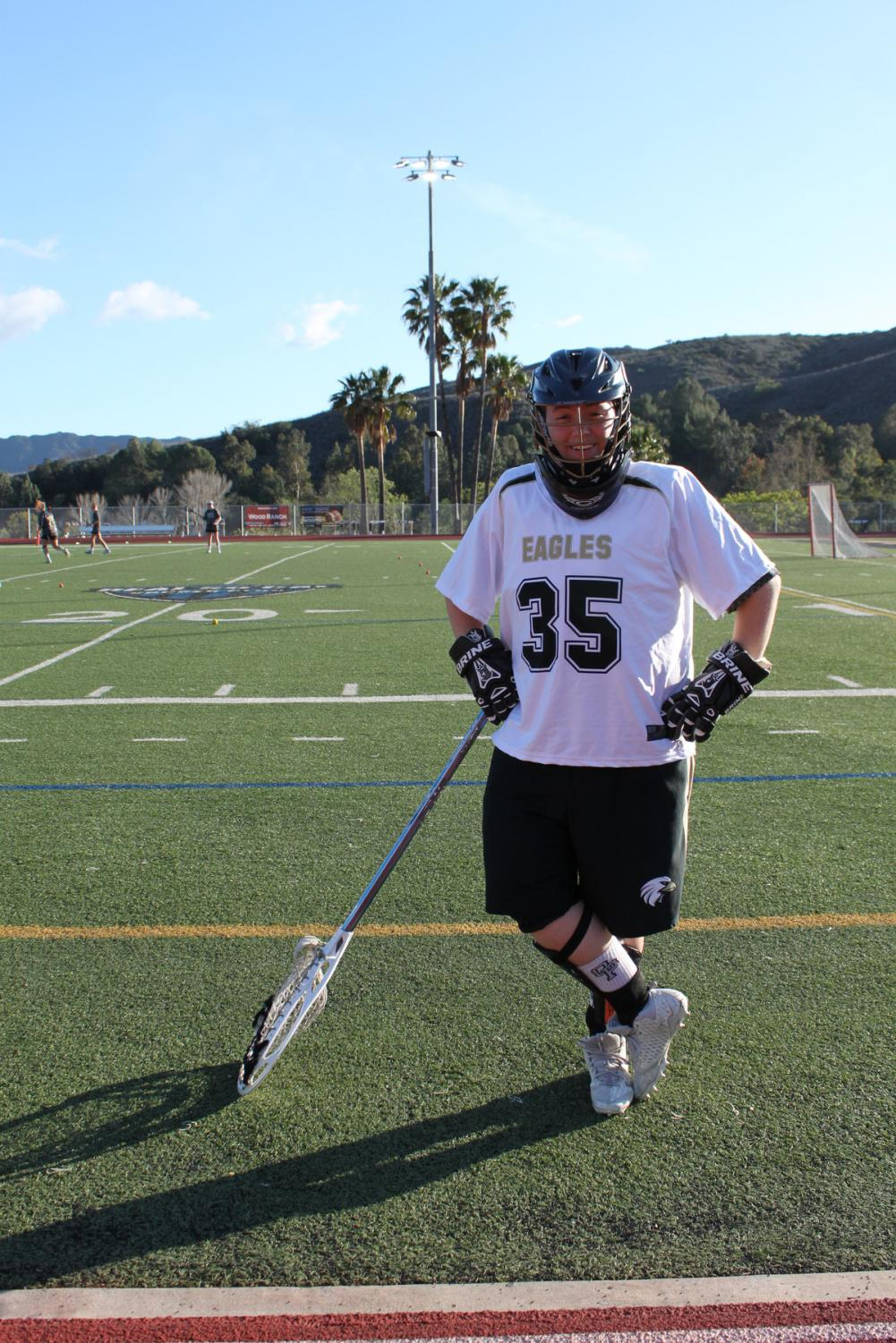 Alexis Robinson captured while playing lacrosse.