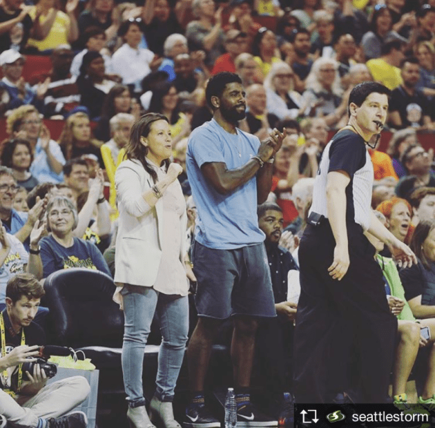 Alisha Valavanis on the sidelines with Kyrie Irving