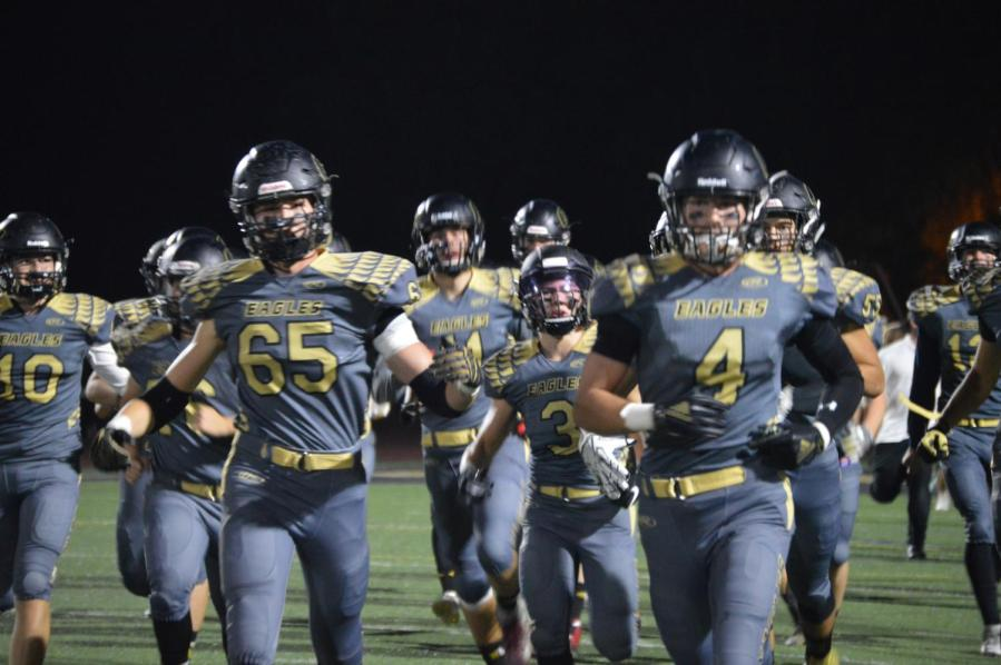 Oak Park Eagles play Brentwood High School in an overtime game and earn win. The varsity football team debuted new jerseys for homecoming game