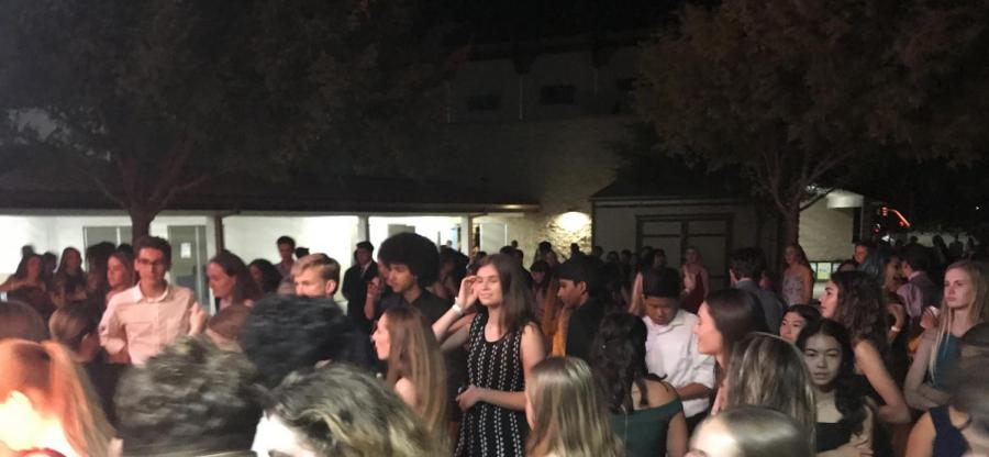 During the homecoming dance, the fire alarm went off twice and students were evacuated to ensure safety