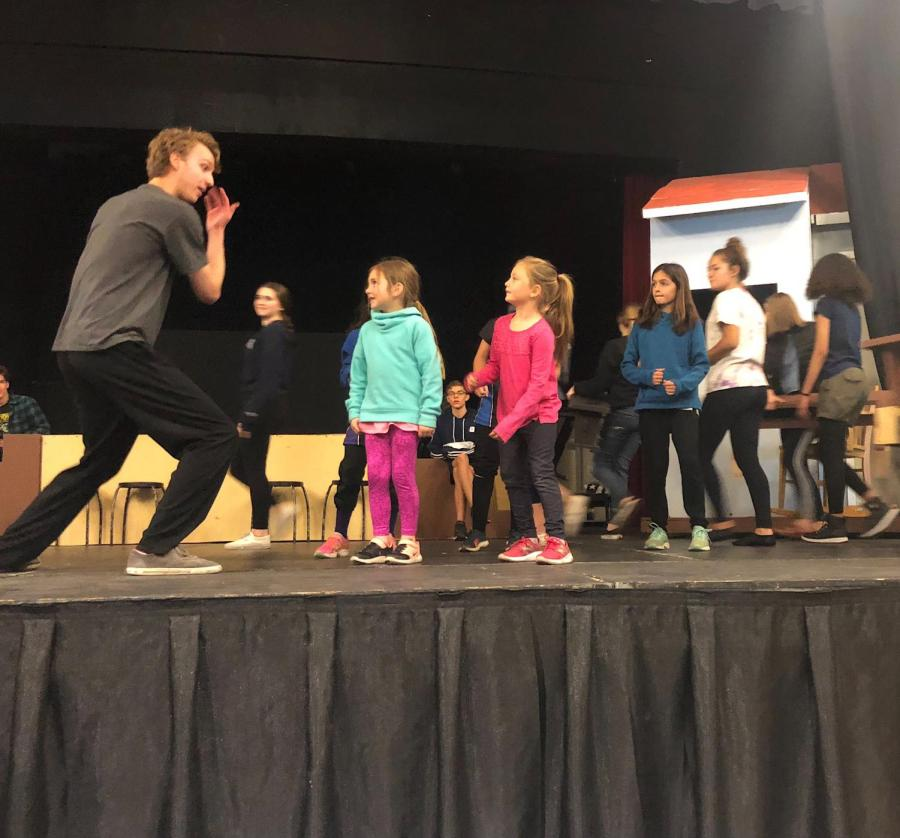 Jeremy+Orriss+performs+along+side+students+form+local+elementary+schools+during+practice+for+the+spring+musical%2C+%22The+Music+Man.%22