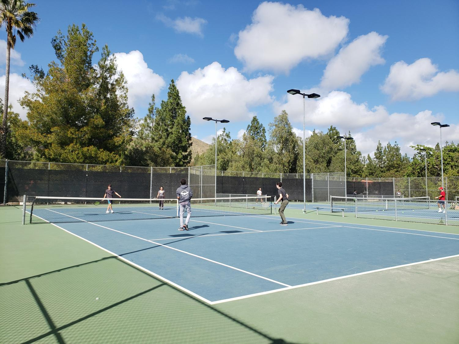 Boys' tennis team practices for CIF tournament. The varsity boys team was undefeated in the 2019 season.
