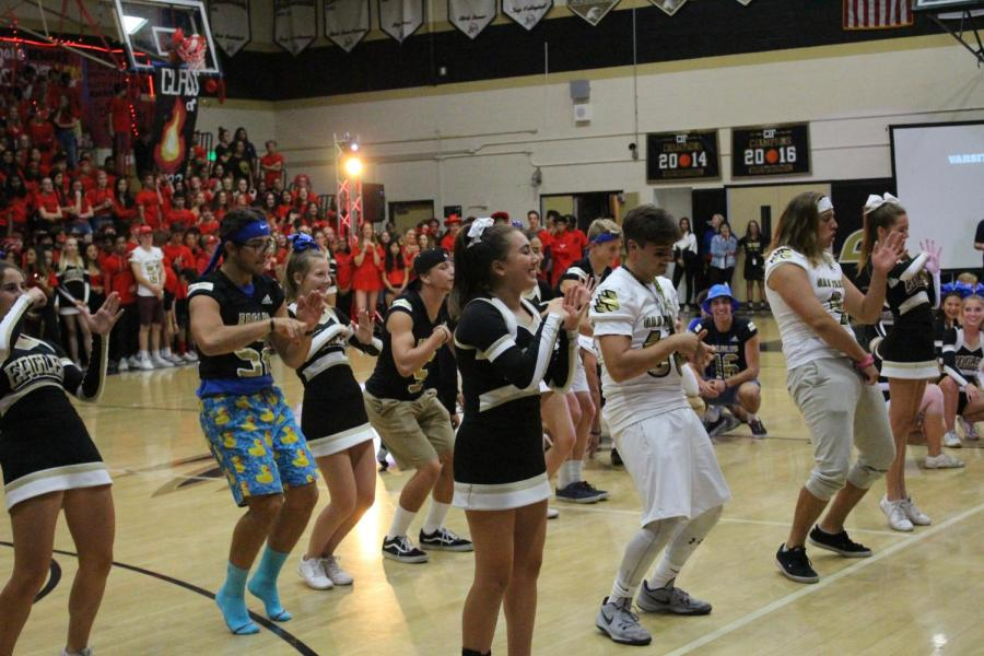 Cheer performs a number with the Football team