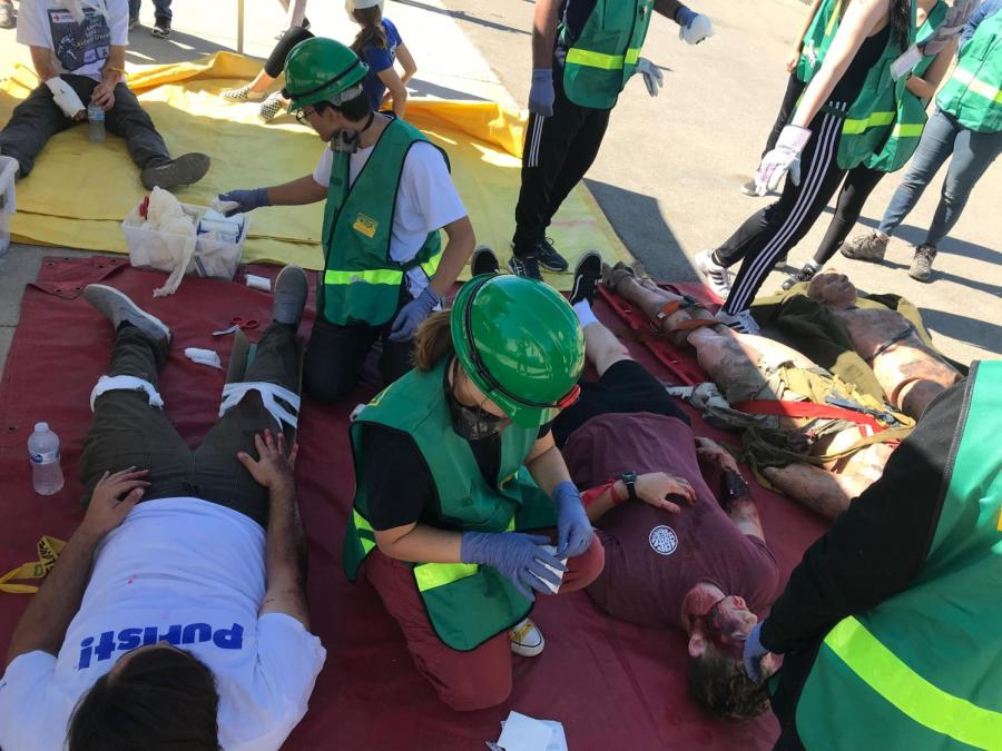 The Teen CERT team successfully completed the first combined drill. Members were placed into search, rescue, fire and medical teams. CERT members on the medical team give medical attention to 'victims' of the drill.