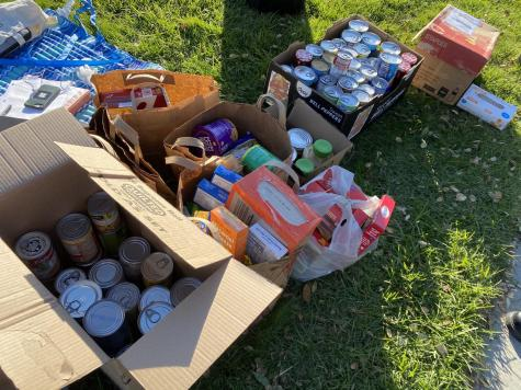 The National Honors Society collects plenty of food on Day 1 of their food drive.