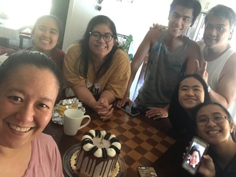 Celebrating a birthday in quarantine with the Tolentino family. From left to right: mom, second eldest sister, family friend (who used to live with them), brother, father, Isabella and Emily. They are FaceTiming the eldest daughter. (Photo courtesy of Isabella Tolentino)