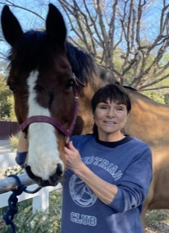 Sharon Stutz poses with her horse Theo.