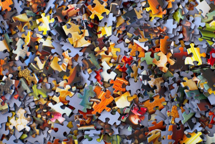 scattered pieces of a jigsaw puzzle