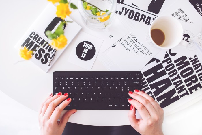 lady with red nails typing